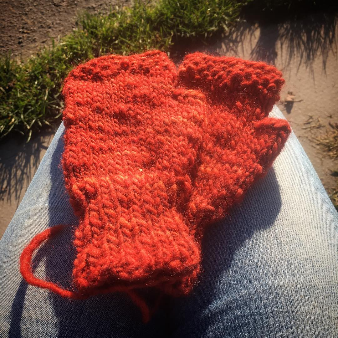 Mittens in the sunshine! I've just finished #testknitting these lovely fingersless mits by @aprilfreshknits – now to weave in the ends so I can wear them! #triskelionyarn #handknit